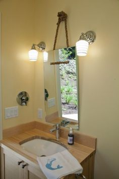 Love the mirror hanging by the Jute Rope contemporary bathroom by Whitney Lyons