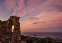 sunrise in Monolithos castle by iliasanthitsas