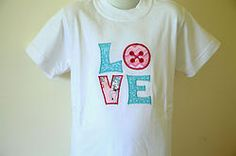 """""""Love"""" embroidered T-shirt $15"""