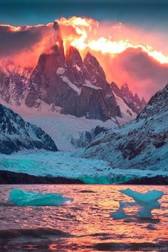 Fire and Ice by michaelanderson on deviantART Laguna Torre, Los Glaciares National Park, Patagonia, Argentina. A fiery sunset illuminates Cerro Torre and the cold icebergs of Laguna Torre, one of the most beautiful lakes in all of Patagonia. All Nature, Amazing Nature, Science Nature, Places Around The World, Around The Worlds, Beautiful World, Beautiful Places, Amazing Places, Beautiful Sunset