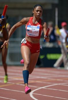 Apr 27, 2013; Philadelphia, PA, USA; Allyson Felix runs the second leg of the USA Red womens 4 x 100m relay in the 119th Penn Relays at Franklin Field. (Kirby Lee-USA TODAY Sports)