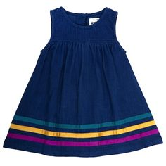 Rainbow Trim Pinafore by UK label Kit Clothing, made from organic cord. Navy cord pinafore with a grosgrain ribbon trim that can be worn by itself or paired with a top inside. Perfect for playing out in the sun or for a nice family day out. Also comes in an skirt with an elastic waist. Available in sizes 6 months to 3 years.