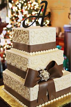 #rustic wedding cake This cake has buttercream piping with fondant bands and a fondant bow.