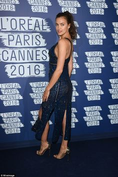 Naughty in navy:In-keeping with her look earlier in the night, Irina opted to keep her beauty regimen the same as she kept things fresh faced and natural