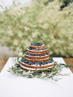 Blueberry covered naked cake: http://www.stylemepretty.com/destination-weddings/2015/02/19/intimate-spring-german-wedding/ | Photography: Lauren Kinsey - http://laurenkinsey.com/