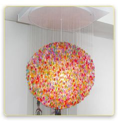 "Gummy Bear Chandelier - Kevin Champeny is the mastermind behind this 32"" in diameter gummy bear chandelier. It's constructed of approximately 5,000 acrylic bears. Each bear is hand-strung, making the process take about two months to complete. Only ten will be made, so visit Jellio soon to put your dibs on one. http://www.jellio.com/store/candelier.html#"