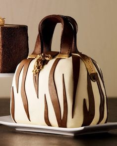 - This Neiman Marcus handbag cake is the ultimate indulgence for your chocoholic, designer fashion-fiending friends. The Zebra-Striped Handbag Cake. Pretty Cakes, Beautiful Cakes, Amazing Cakes, Unique Cakes, Creative Cakes, Shoe Cakes, Cupcake Cakes, Purse Cakes, Torta Animal Print