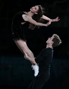 Elena Ilinykh and Nikita Katsalapov of Russia perform during the figure skating exhibition gala at the Iceberg Skating Palace during the 2014 Winter Olympics, Saturday, Feb. 22, 2014, in Sochi, Russia. (AP Photo/Ivan Sekretarev)