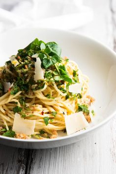 This Garlic Butter White Wine Pasta with Fresh Herbs recipe is so easy but SO good! Made with a delicious sauce, fresh herbs, breadcrumbs, lemon and cheese. | savorynothings.com