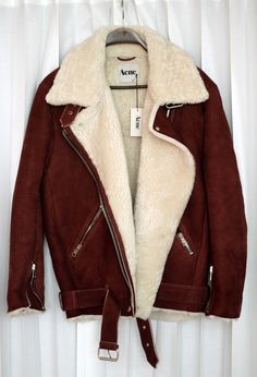 That's exactly my dream jacket. Motorbiker style, burgundy, sheep hair