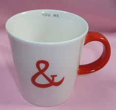 "2013 Starbucks Valentines Day You & Me Love Red Ampersand Handle White Coffee Mug Cup  Measures 3 3/4"" tall and 3 5/8"" wide without the handle, 5"" wide including handle  Holds 12 oz  Excellent Used Condition - No cracks, chips or breaks"