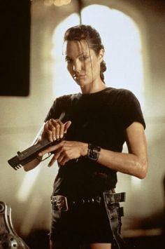 "Sara Jendusa, Vogue.com Art Producer - ""Angelina Jolie circa 2001 in Tomb Raider. Minimal effort, maximum impact."""