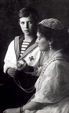 Empress Alexandra Feodorovna and her son, Tsarevich Alexei. The sautoir of pinkish pearls is what Alexei is playing with, the most expensive of Faberge's commissions, given to Alix as part of her engagement presents.