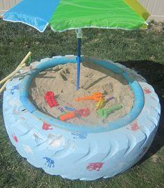 tire sandbox + umbrella= greatness.