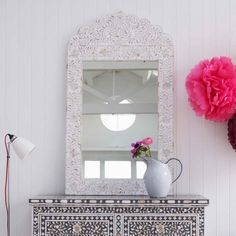 Use the floral-ish intricate design on the dresser for my mirror frame