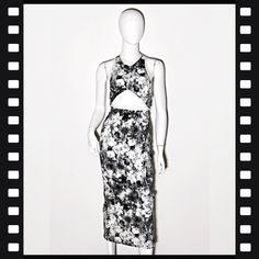 5fc539cea0 Size 8 cut-out dress by Manning Cartel. Black and white floral print with