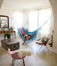 Hammocks can stand in as worldly alternatives to love seats in eclectic living rooms.