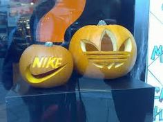 Brand your #pumpkins by having your company logo carved into them for your next #halloween window display. #windowdisplay