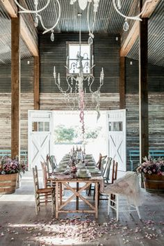 The Prairie By Rachel Ashwell - eclectic - Dining Room - with galvanized panels for ceiling area.