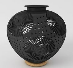 Oaxacan black pottery, barro negro.  I brought one back with me created by Dona Sophia