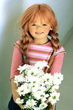Margie by Annette himstedt...OK!!!  My Mama Jon lived next door to 3 Margie's!  All from the same house...1st two past away.  1 one had a doll like this that had belonged to her dead daughter!!  CREEPY!!!