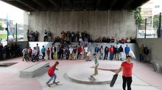 Using the space under an overpass for a skatepark. Opening day of PLAYscapes at Mill St Skatepark. Image via Building Trust International