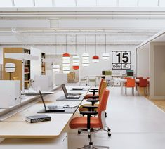 Clean office, open office space with pops of color...