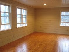Flooring $1/sq foot-- cutdown plywood sheets to 3 lengths, apply to subfloor with liquid nails, stain and use a water based polyurethane (I would go darker, but great idea)