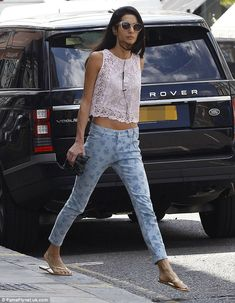 Out and about: Amal Alamuddin, who is said to be planning a September wedding to George Clooney, was seen showing off her toned tum in a lac...
