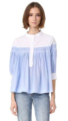 ¡Consigue este tipo de blusa con volantes de ENGLISH FACTORY ahora! Haz clic para ver los detalles. Envíos gratis a toda España. ENGLISH FACTORY Button Down Blouse: A striped ENGLISH FACTORY blouse styled with pleats and a flared hem. Contrast yoke and partial button placket. 3/4 sleeves and button cuffs. Semi-sheer. Fabric: Shirting. 100% cotton. Hand wash. Imported, China. Measurements Length: 23.5in / 60cm, from shoulder Measurements from size S (blusa con volantes, voilé, voile, volan...
