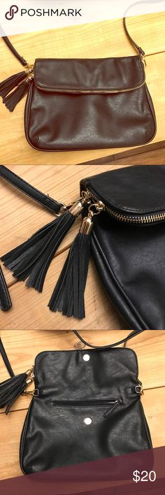Black fold over purse with tassels Only carry once. Adorable bag with tassels, zippers and tons of pockets! Bags Shoulder Bags