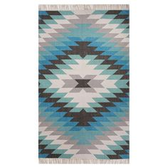 Lend a touch of Southwestern flair to your porch or patio with this eye-catching indoor/outdoor rug, showcasing a diamond motif and fringed ends.