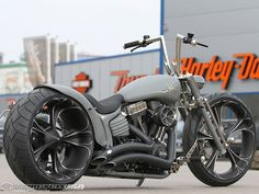 Thunderbike Customs of Germany took a stock Harley Rocker and gave it the Thunderbike treatment, its nickel-plated parts and flat grey paint lending to its Nickel Rocker name.