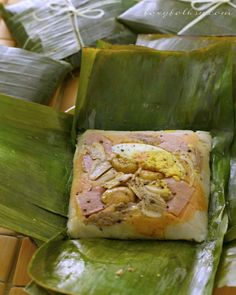 This is the Filipino version of Tamales which is very different from the Mexican one. Made of ground rice, coconut milk and various toppings like chicken, ham, nuts  and egg. | www.foxyfolksy.com