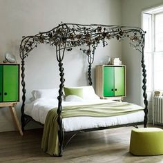 Secret garden bedroom Twisted steel and copper bed celebrates all that is wild and magical about nature.
