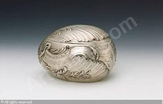 Studio of FABERGÉ Karl (Carl), 1846-1920 (Russia) Title : Egg-shaped box  Date : ca 1890   Category : Silver Medium :   : Silver egg-shaped box, finely repoussé and chased with rocaille scrolling, the hinged lid similarly decorated