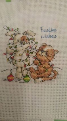 Made a start on your christmas cards from the recent issue of woxs #DMC #Threads #crossStitch #etamin #embroidery #fabric #decorate #pattern #ornament