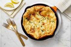 """Golden, crunchy, and covered in a salty, frico-like layer of baked Parmesan"" this herbed Parmesan Dutch baby is perfect ""for dinner with a big salad or for brunch. Brunch Dishes, Brunch Recipes, Baby Food Recipes, Breakfast Recipes, Dinner Recipes, Cooking Recipes, Breakfast Skillet, Amish Recipes, Savory Breakfast"