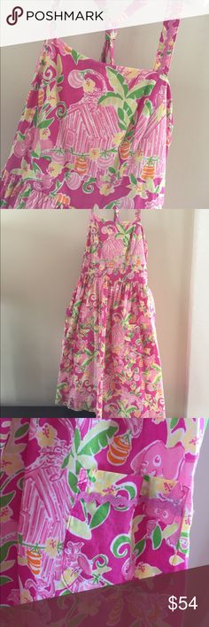 Lilly Pulitzer Girls Dress Size 10 Lilly Pulitzer Girls Dress Size 10. Adorable cotton dress for spring and summer. While this can certainly be dressed up, the flowy shape makes it casual enough to be an every day dress for a girly girl! Shoulder straps cross in the back and attach with buttons. This is one of the cutest Lilly prints I've seen--pink monkeys and elephants! Lilly Pulitzer Dresses