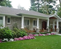 Take out bare flower bed on right and extend porch and add an awning