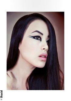 Graphic black eyeliner pale lips