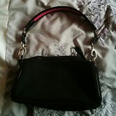 The Sak handbag. The Sak black purse with pink trim on strap. The Sak Bags Shoulder Bags