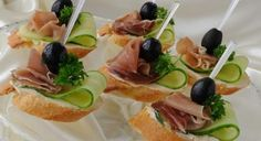 Canapes with ham by Apolonia. Mini sandwiches with ham and cucumber on a baguette Vegetable Appetizers, Finger Food Appetizers, Appetizers For Party, Finger Foods, Canapes Recipes, Appetizer Recipes, Snack Recipes, Snacks, Tapas