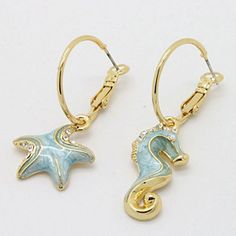 """Luula seahorse and starfish earrings. Love these. It goes against the my """"Monk"""" symmetrical thing, but I love these."""