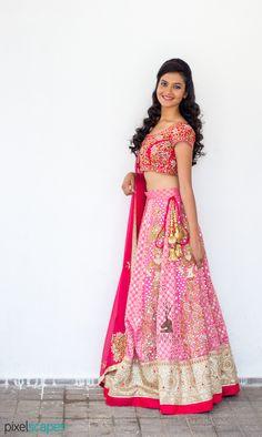 Carved lady pink #lehenga with #mirrorwork, #threadwork and #nakshiwork.  Visit…