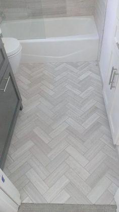 Chevron tile floor herringbone tile floor bathroom chevron tile floor bathroom flooring light tile in herringbone Chevron Bathroom, Grey Bathroom Floor, Chevron Tile, Grey Floor Tiles, Hall Bathroom, Upstairs Bathrooms, Bathroom Kids, Grey Flooring, Bathroom Renos