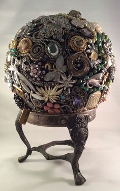 Vintage jewelry gazing ball with silver plated vintage stand.