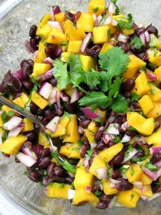 Mango Black Bean Salsa - A Hint of Honey I serve this over chicken taco's made with corn tortilla's, then add a dollop of sour cream and YUM!!!!