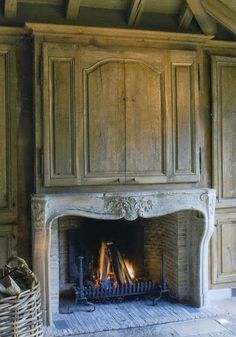 French stone mantel,  South Shore Decorating Blog: Fireplace Mantels, Oversized Mirrors, and More