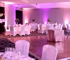 Alternating between two up-lighting colours can be very effective. Josie and Tyler went for purple and soft white up-lighting which looked fantastic in this larger room.